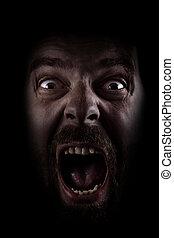 Scream of scared spooky man in dark - Scared face of spooky ...