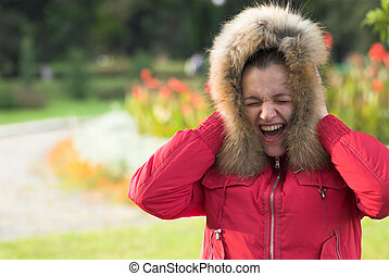 Scream - Young woman is screaming on flowered background