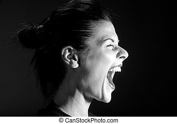 The black-and-white image of the shouting girl