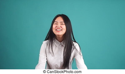 Screaming Asian Girl Covering Her Ears With Closed Eyes. -...