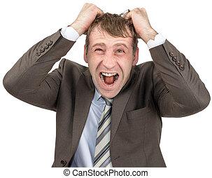 Screaming businessman tearing his hair