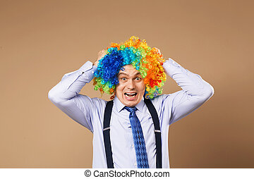 screaming businessman with large colorful wig.