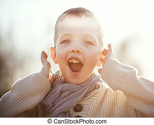 Screaming child portrait of little boy playing