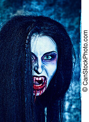 screaming evil - Close-up portrait of a bloodthirsty female...