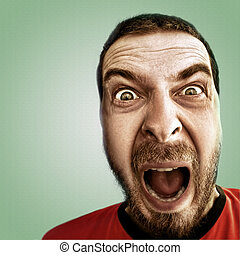 Screaming face of shocked funny man