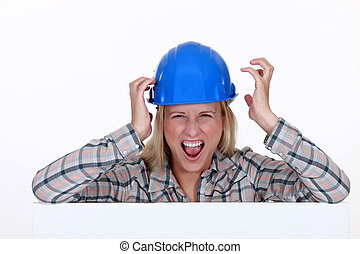 Screaming female construction worker