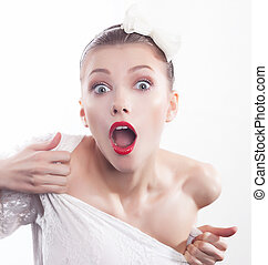 Screaming girl with red lips close up portrait