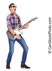 screaming guitarist playing - guitarist playing his electric...