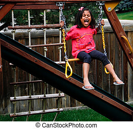 screaming Hispanic female child on