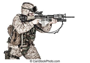 Screaming machine gunner soldier shooting from waist