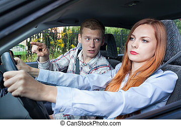 Screaming man and driving woman