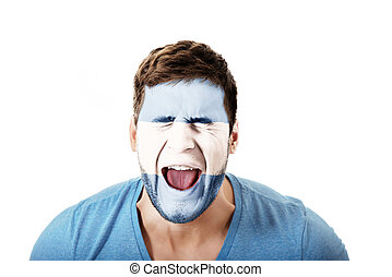 Screaming man with Argentina flag on face.