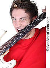 Screaming man with guitar in hands