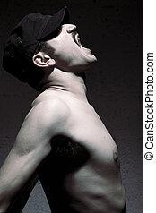Screaming Mustache Guy - Studio shot of an adult man in his...