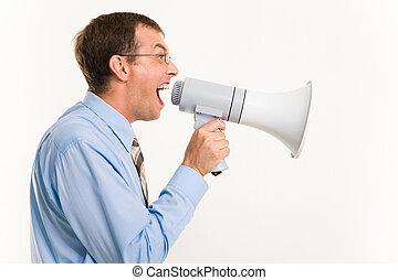 Screaming - Profile of man shouting through megaphone...
