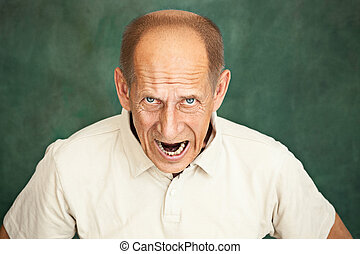 Screaming Senior Man - The screaming mature or senior man at...
