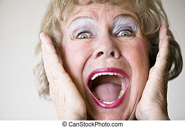 Screaming Senior Woman - Close-up of a senior woman with her...