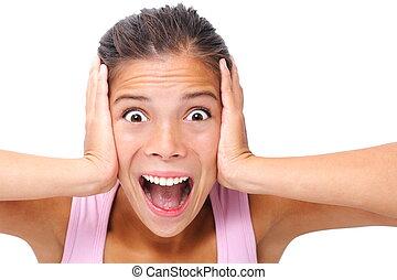 Screaming woman studio shot on white background. Beautiful...