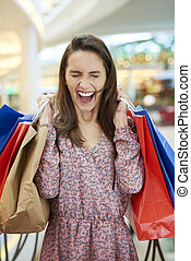 Screaming woman with shopping bags