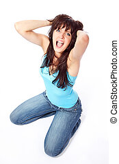 Screaming young woman holding head
