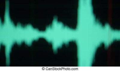 Audio Waves on Screen. Liquid Crystal Structure IPS Matrix. Digital Electronic Equalizer on a Computer Monitor. Red Line Reads the Sound Signal. Recording Studio, Music, Sound wave. Defocused. Blurred