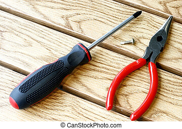Screwdriver and Plier tools for handy do-it-yourself in a...