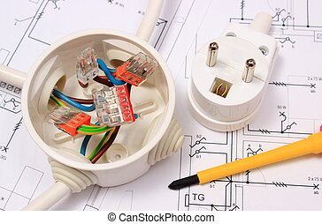 Screwdriver, electrical box and electric plug on construction drawing