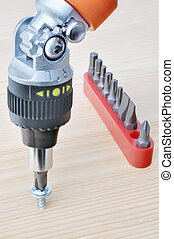 Screwdriver - The set of heads and screwdriver on board