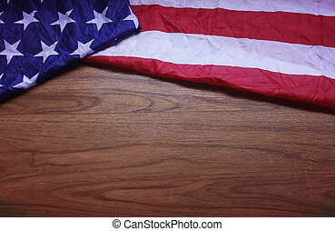 Screwed Up USA Flag on Brown Wooden Board Background