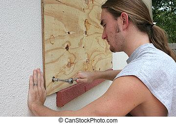 Screwing Plywood on Window