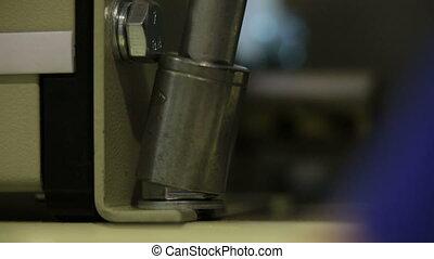 Screwing screws by tool closeup