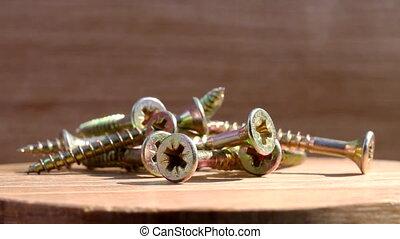 screws on rotating plate