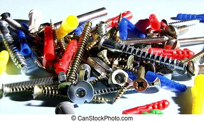 Screws, plugs - Screws, nuts and anchors. Moving.