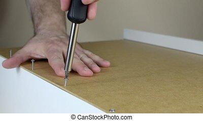 Screws Set in a Row - Close-up of screwing a few screws set...