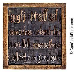 script alphabet in wood type