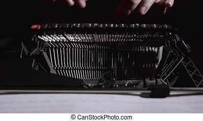 Script writer on a typewriter writes a screenplay for the...