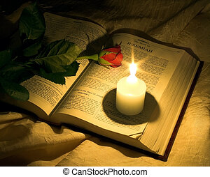 Scripture - open bible with a rose and candle, light sourced...