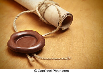 Scroll with wax seal on a wooden table