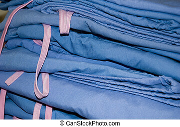 Pile of surgery / hospital scrubs light blue color