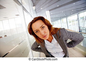 Scrutiny - Portrait of serious businesswoman looking at ...