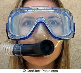 A young woman in scuba gear.