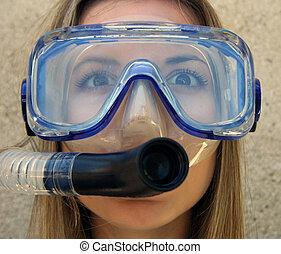 Scuba - A young woman in scuba gear.