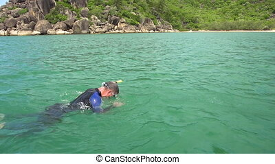 Scuba diver snorkeling and mountains
