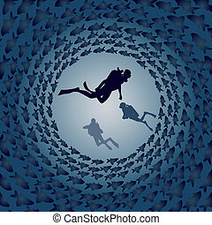 Scuba divers and fish - The group of divers in the...