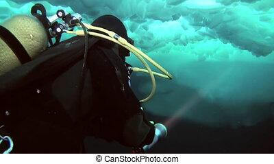 Scuba diving in Arctic at geographic North Pole. - Unique...