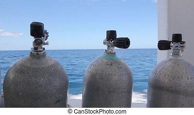 Scuba Tanks. - Scuba tanks on speeding dive boat. Shallow...