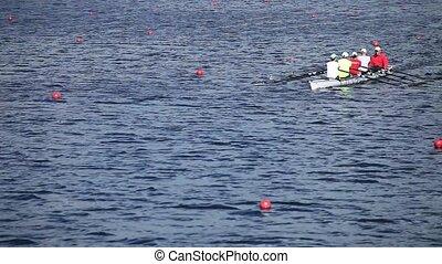 Sculling  four men rowing
