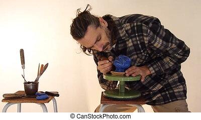 Sculptor at work on a miniature head