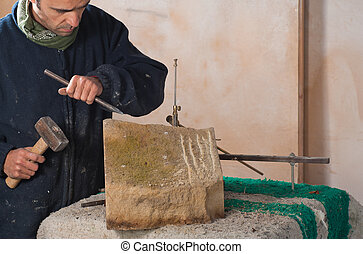 Sculptor just starting to carve art out of stone