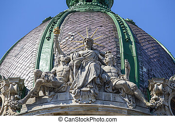 Sculptural composition with sitting Statue of Liberty at the dome of the old house in Lviv, Ukraine